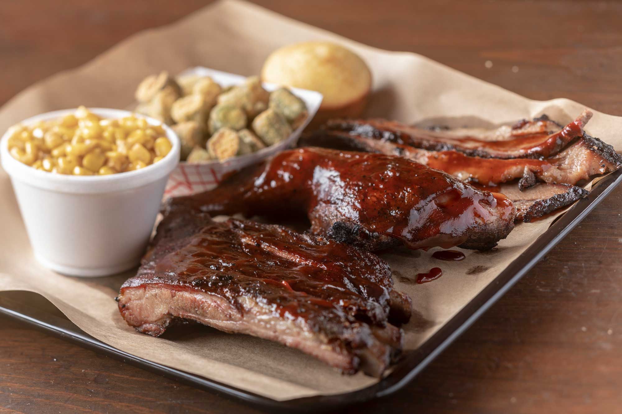 Smoked Ribs with side dishes by Bad to the Bone Barbecue
